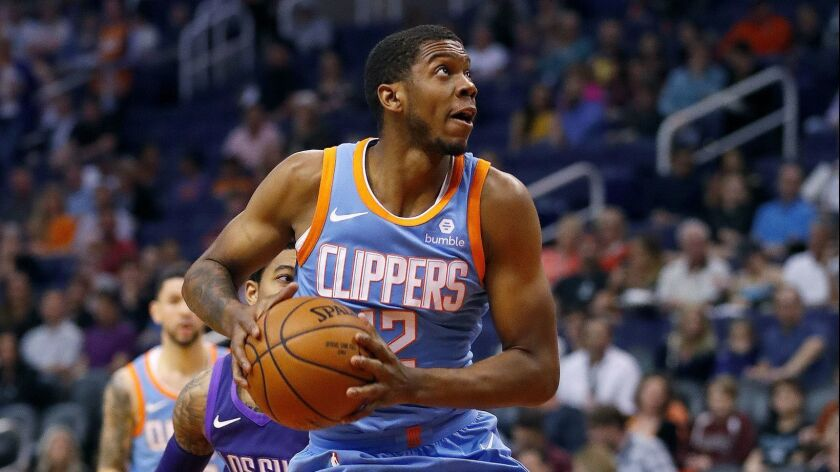 LA Clippers guard Tyrone Wallace (12) drives past Phoenix Suns guard Tyler Ulis (8) during the first