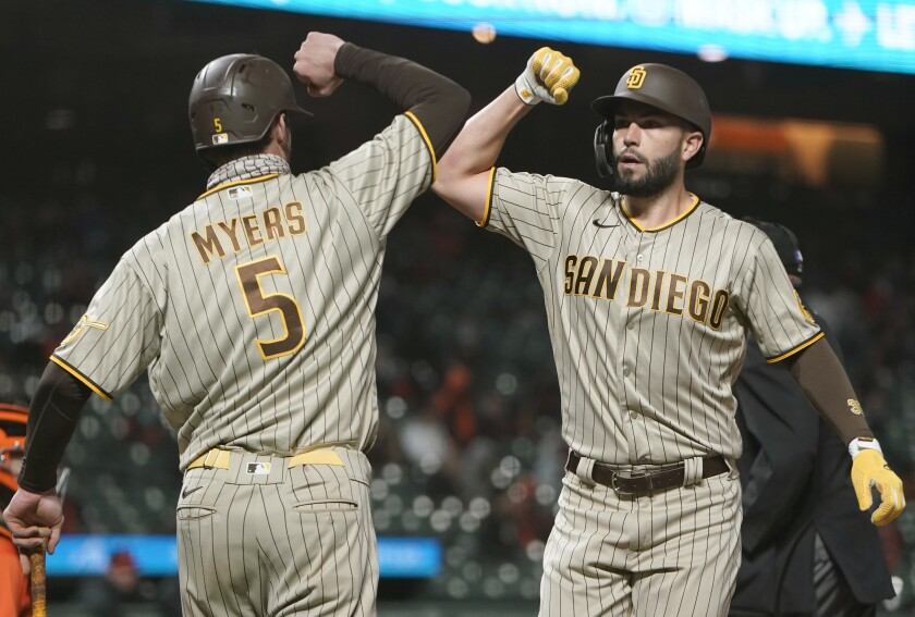 The Padres' Eric Hosmer is congratulated by Wil Myers after Hosmer hit a two-run home run