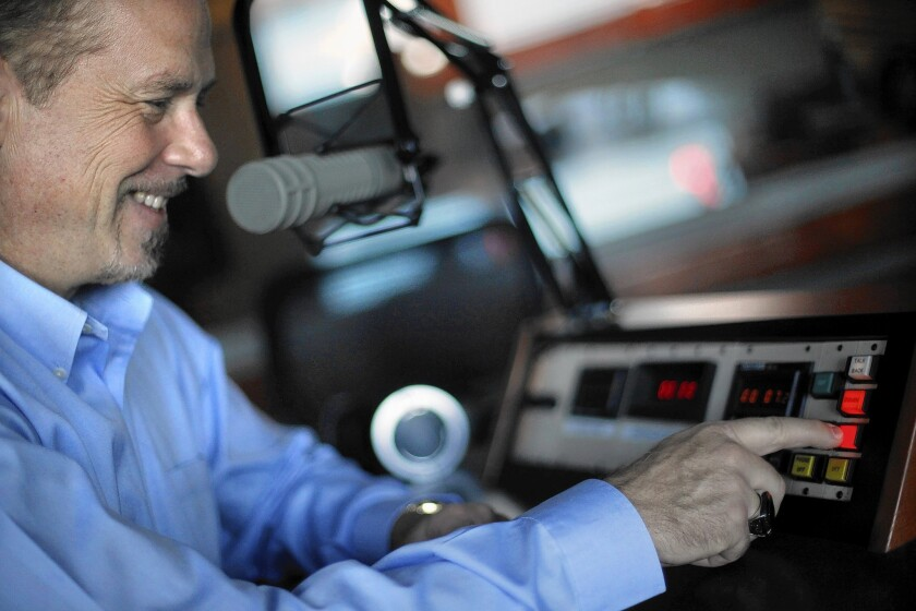 "Longtime newscaster Phil Hulett, who hosted his last show for KFWB-AM in August, works at the console in San Pedro where he does his podcast, ""Phil Hulett and Friends."""