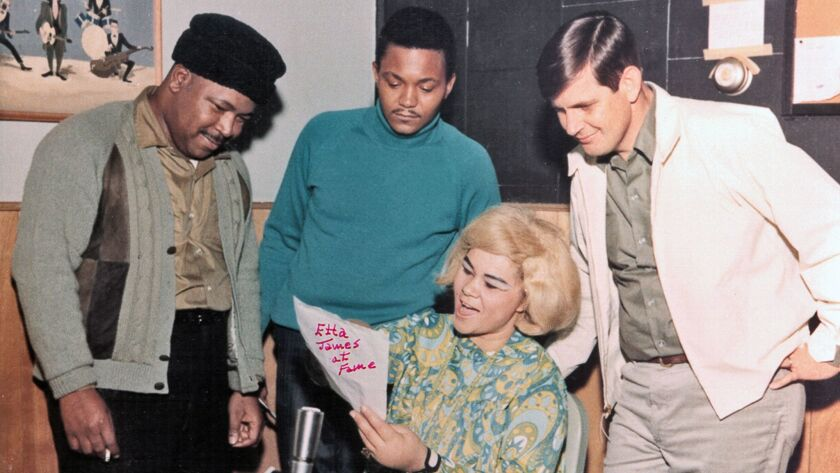 R&B singer Etta James rehearses as Fame Studios owner Rick Hall, right, and members of the house band look on during a recording session circa 1967 in Muscle Shoals, Ala.