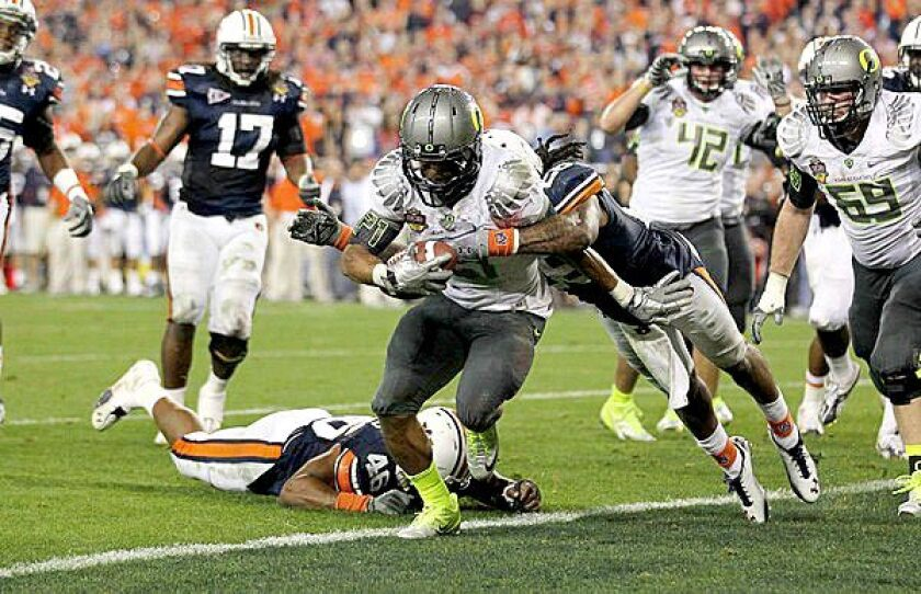 Oregon running back LaMichael James scores on a shovel pass against Auburn in the fourth quarter during the 2010 BCS National Championship game in Glendale, Ariz.