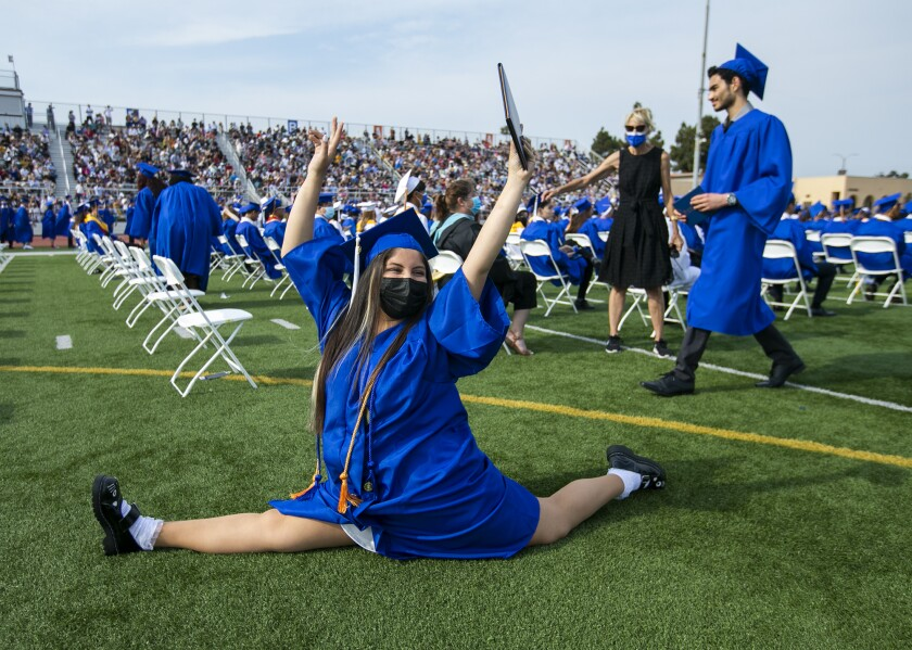 Vivian Espinoza does the splits during the 2021 Fountain Valley High School commencement ceremony.
