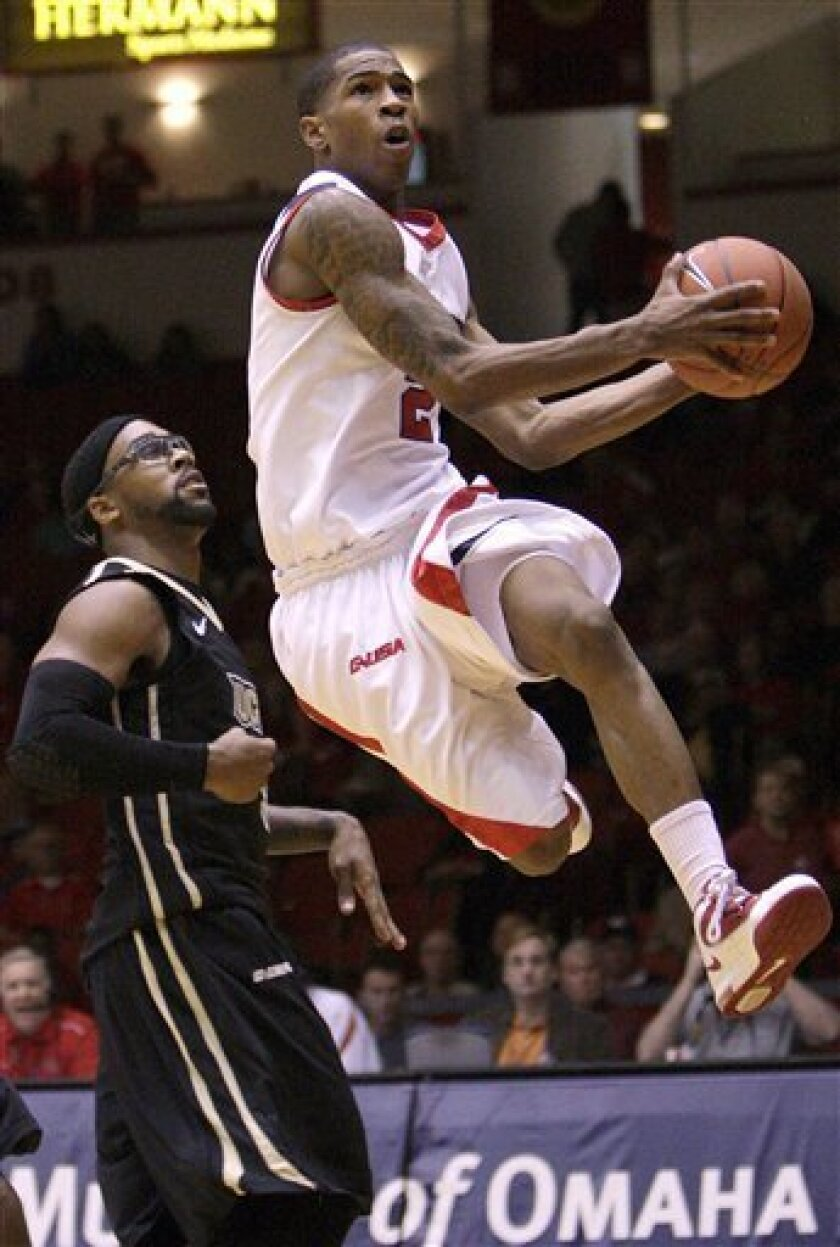Houston's Zamal Nixon (2) drives the basket past Central Florida's Marcus Jordan (5) for a layup during the second half of an NCAA college basketball game Saturday, Jan. 8, 2011 in Houston.(AP Photo/Bob Levey)