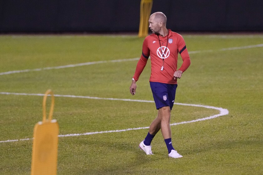 United States head coach Gregg Berhalter walks on the pitch during a training session ahead of the FIFA World Cup Qatar 2022 qualifying soccer match between Honduras and the United States in San Pedro Sula, Honduras, Tuesday, Sept. 7, 2021. (AP Photo/Moises Castillo)
