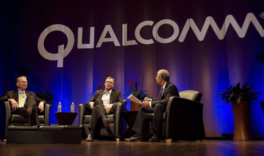 Qualcomm's Irwin (left) and Paul (center) Jacobs discuss the 25 year history of the company with a moderator at Qualcomm's headquarters in Sorento Valley. File photo from August 2010.