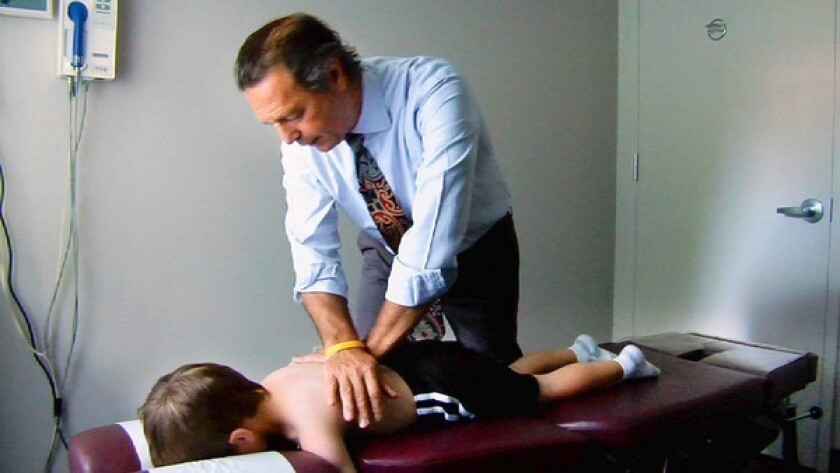 """Dr. Peyser with a patient in a scene from the documentary """"Doctored."""""""