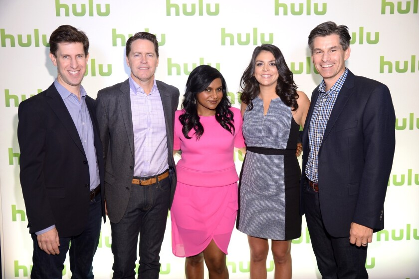 From left, Craig Erwich, Peter Naylor, Mindy Kaling, Cecily Strong and Mike Hopkins attend Hulu's Upfront Presentation in New York City.