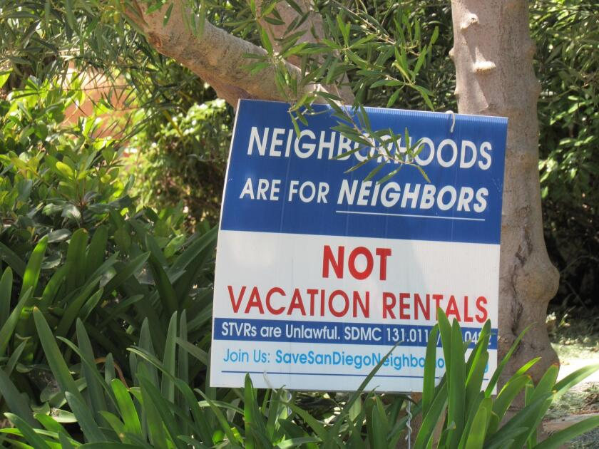 Signs like this have popped up in La Jolla in recent years in opposition to short-term rentals in neighborhoods.