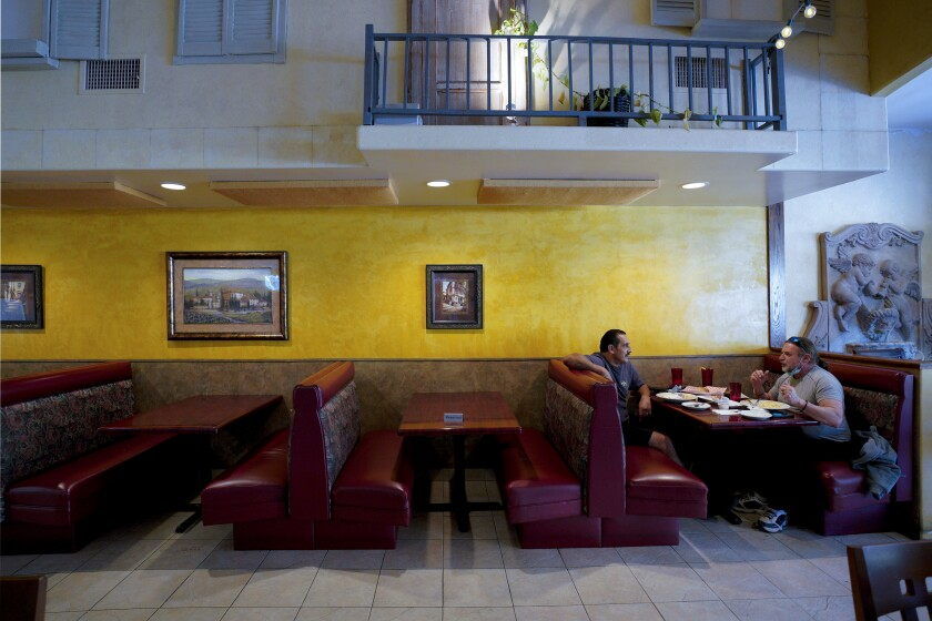 Two patrons enjoyed their lunch break in Testo Pepesto's dining room in downtown El Cajon.
