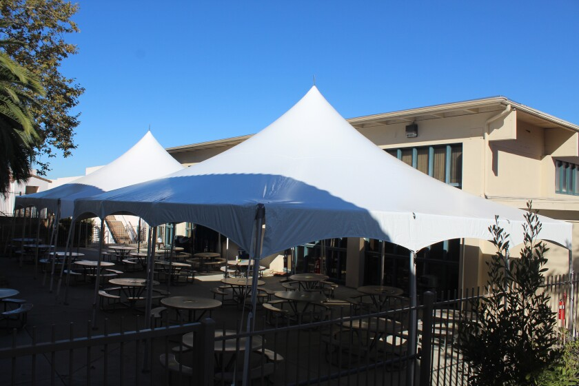 Newly installed tents on the R. Roger Rowe campus.