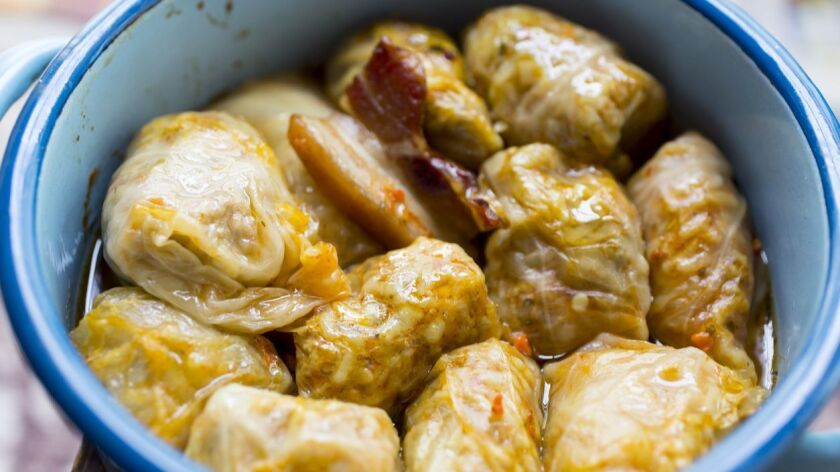 Sarma , traditional Balkan and Eastern European holiday food - rolled up cabbage leaves stuffed with rice and minced meat