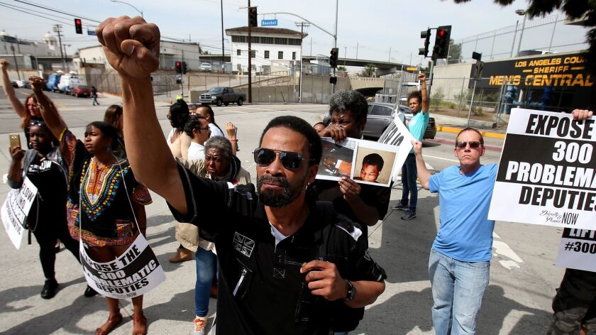 LOS ANGELES, CALIF. - MAR.10, 2017. Protesters at an event organized by jail reform advocates block