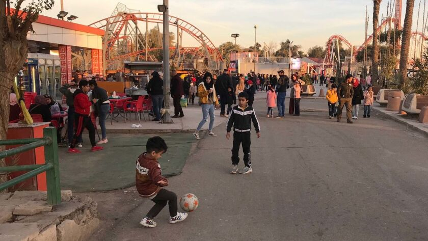 Children play at Baghdad's Zawraa Dream Land, an amusement park opened in 1971.