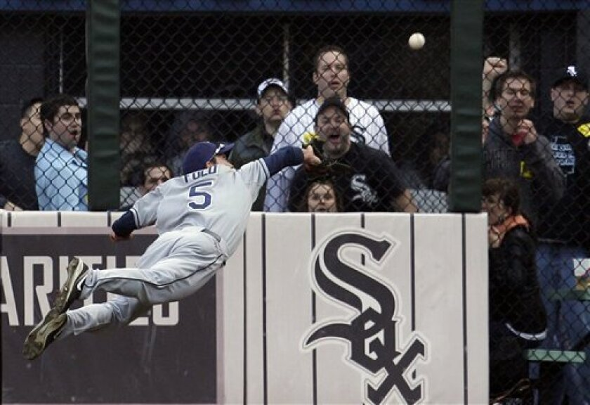 Tampa Bay Rays right fielder Sam Fuld makes a diving catch on a fly ball hit by Chicago White Sox's Juan Pierre during the fourth inning of a baseball game in Chicago, Saturday, April 9, 2011. (AP Photo/Nam Y. Huh)