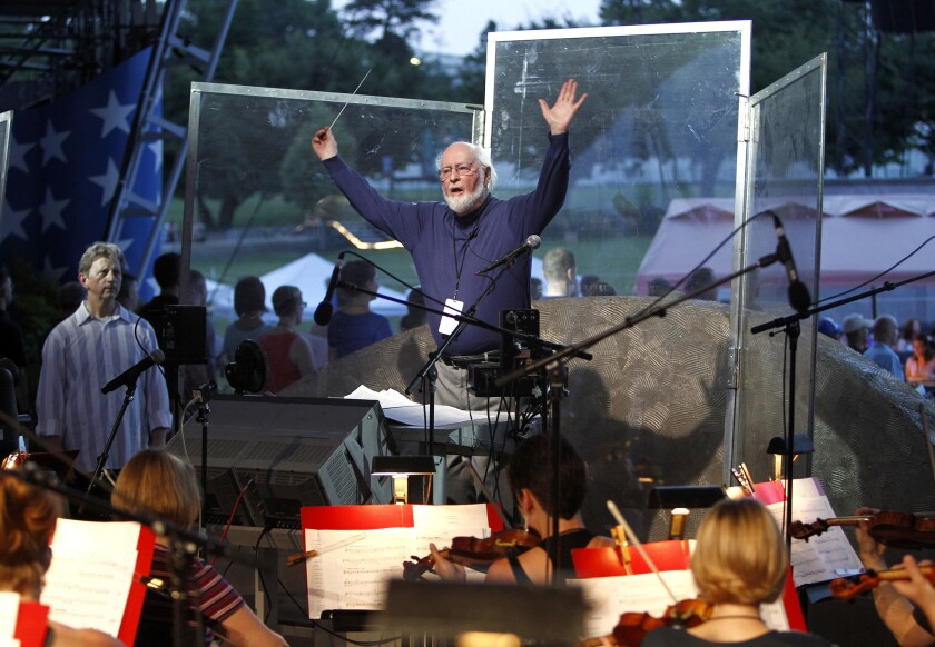John Williams conducts the National Symphony Orchestra and other musicians for the upcoming debut of a new arrangement of the national anthem.
