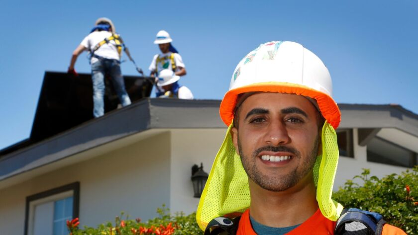 Mohamed Hauter is a volunteer with GRID Alternatives San Diego, which provides solar power to low-income families.