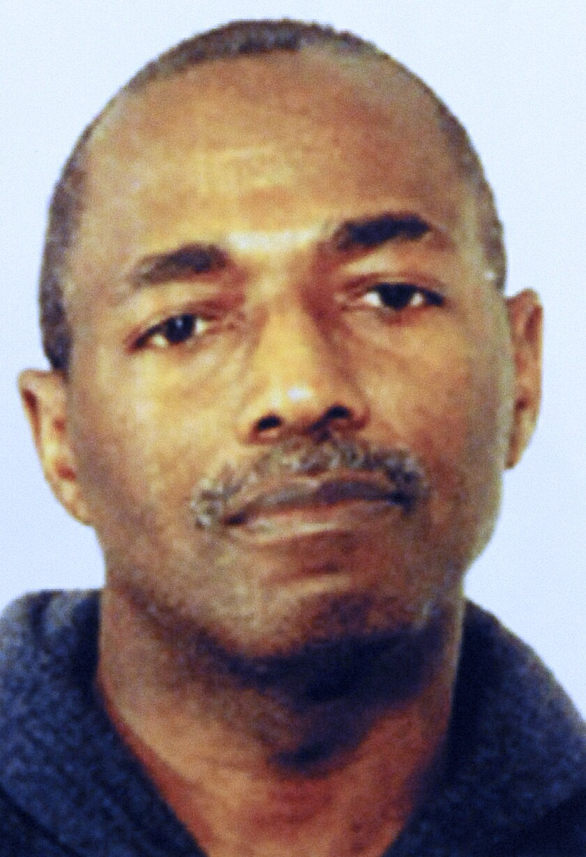 This July 2013 photo shows former Chicago police officer Eddie Hicks. Hicks a former Chicago police officer who was captured nearly 15 years after he fled while awaiting trial on drug charges was sentenced Thursday, Oct. 1, 2020 to 13 years in federal prison. (FBI/Chicago Sun-Times/Chicago Sun-Times via AP)
