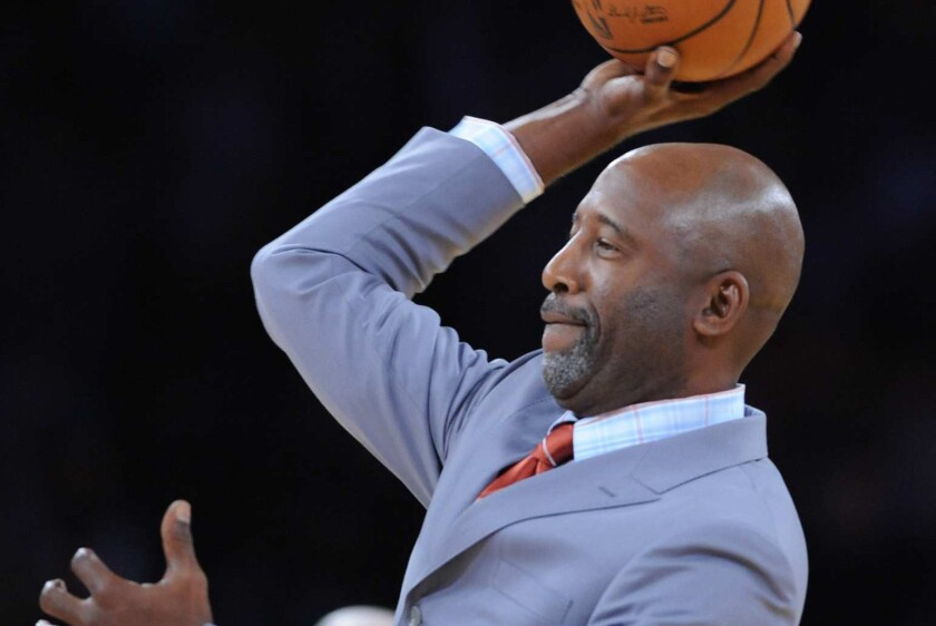 Lakers great and basketball analyst James Worthy has been hired to help coach the team.