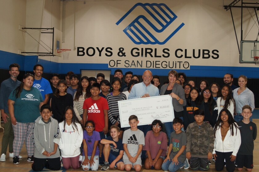 Zephyr Foundation Executive Vice President Jim McMenamin presented their $50,000 donation to Boys & Girls Clubs of San Dieguito CEO Marineke Vandervort at the Harper Branch on Aug. 30.
