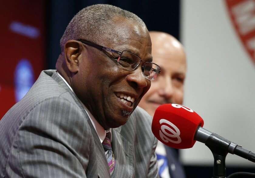 FILE - In this Nov. 5, 2015 file photo, new Washington Nationals baseball manager Dusty Baker, left, accompanied by general manager Mike Rizzo speaks during a news conference in Washington. As they try to forget about 2015 and get started on 2016 at spring training, the best news for the Washington