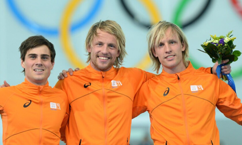 Silver medalist Jan Smeekens, left, gold medalist Michel Mulder, center, and bronze medalist Ronald Mulder celebrate their podium sweep for the Netherlands in the men's 500-meter speedskating competition at the 2014 Sochi Winter Olympic Games on Monday.