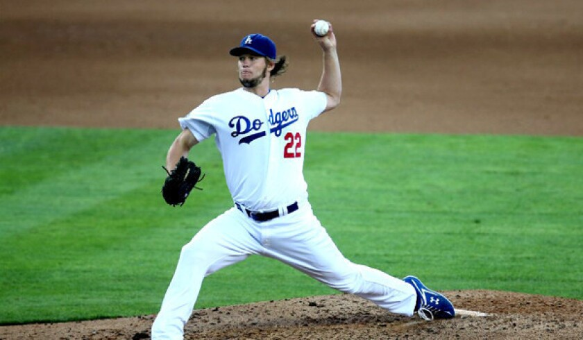 Dodgers left-hander Clayton Kershaw throws a pitch against the Giants on Oct. 3, 2012.