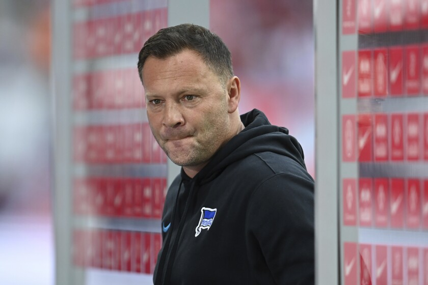 Hertha coach Pal Dardai reacts after the German Bundesliga soccer match between RB Leipzig and Hertha BSC Berlin in Leipzig, Germany, Saturday, Sept. 25, 2021. Hertha Berlin backer Lars Windhorst losing patience with lack of progress.It was the second successive heavy defeat Hertha suffered against one of the teams Windhorst wants to challenge as part of his vision of turning Hertha into one of Germany's best. (Robert Michael/dpa via AP)