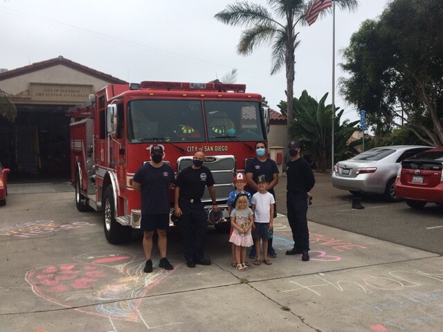 """Young residents meet first responders stationed at La Jolla's Fire Station 13 during a """"Chalk Up"""" on Labor Day."""