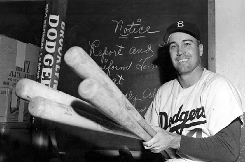 Brooklyn Dodgers center fielder Duke Snider holds one bat for each of the four home runs he hit in the 1952 World Series against the New York Yankees. [For the record: An earlier version of this caption said Snider hit four home runs in Game 6 of the 1952 World Series. Snider hit two homers in Game 6, and four in the entire series.]