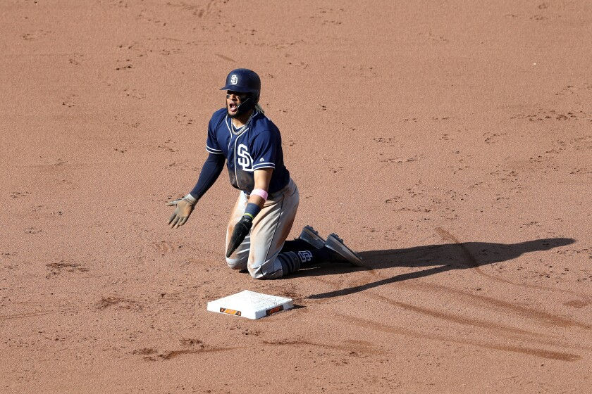Fernando Tatis Jr. reacts after being called out trying to steal second base. The out call was reversed on a replay review, the second time in the inning the Padres rookie was called out and then ruled to be safe.
