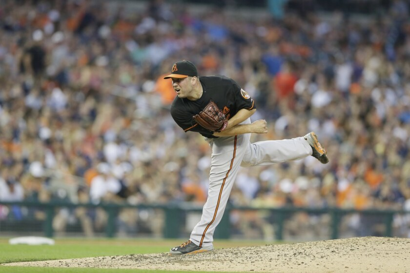 Former Baltimore Orioles pitcher Tommy Hunter throws against the Detroit Tigers.