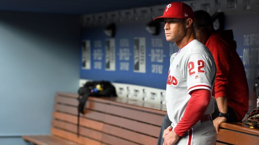 Philadelphia Phillies manager Gabe Kapler realxes in the dugout before a game against the Dodgers at Dodger Stadium on Wednesday.