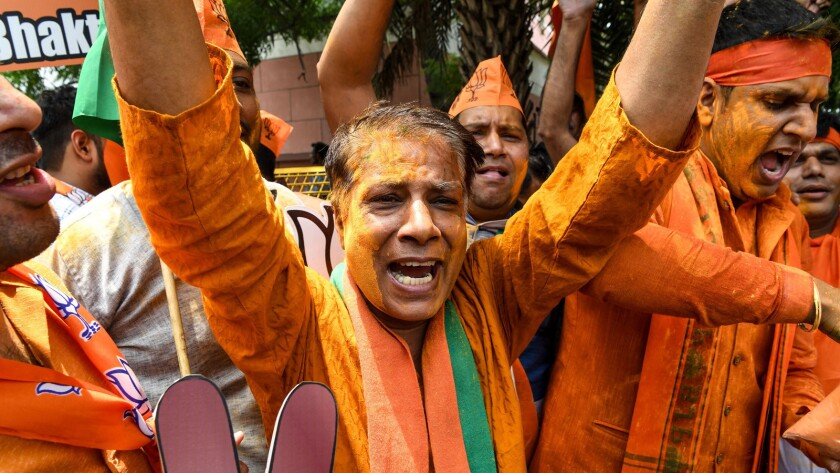 Supporters of Prime Minister Narendra Modi's party celebrate the results of India's election Thursday in New Delhi.