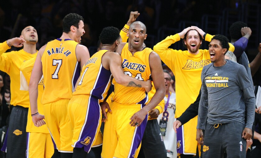 Lakers teammates reacts as he finishes his final game with 60 points.