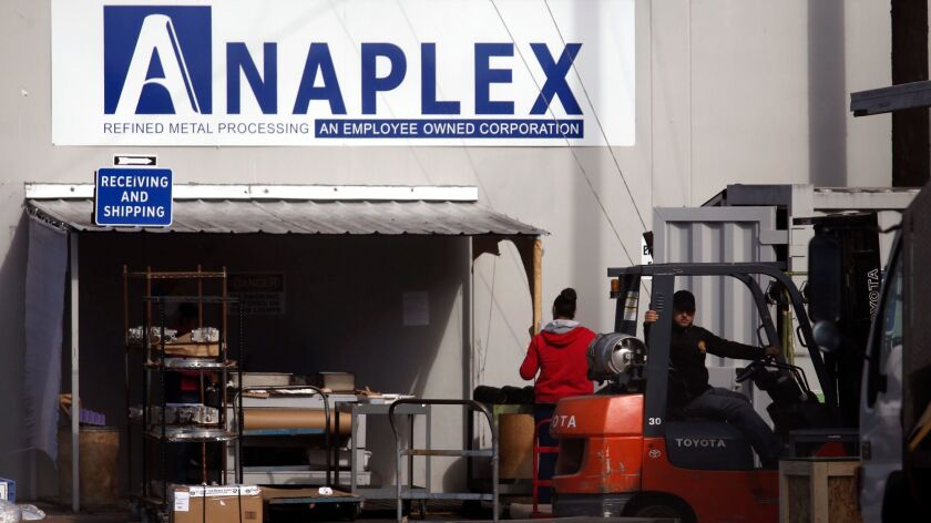 Employees at the Anaplex Corp. in Paramount. The metal plant is one of two ordered by L.A. County health officials to stop endangering the health of the public.