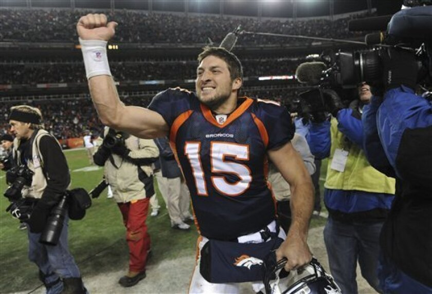 Denver Broncos quarterback Tim Tebow (15) celebrates after beating the Pittsburgh Steelers 29-23 in overtime of an NFL wild card playoff football game Sunday, Jan. 8, 2012, in Denver. (AP Photo/Chris Schneider)