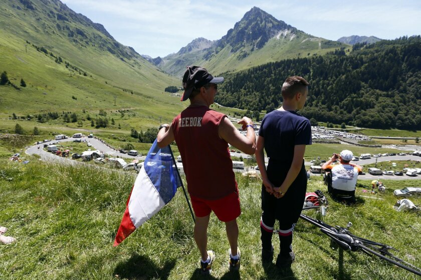 Spectators watch the riders during the eighth stage of the Tour de France cycling race over 184 kilometers (114.3 miles) with start in Pau and finish in Bagneres-de-Luchon, France, Saturday, July 9, 2016. (AP Photo/Peter Dejong)