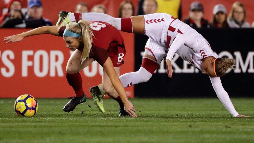 United States midfielder Julie Ertz, left, battles Denmark midfielder Sanne Troelsgaard for the ball