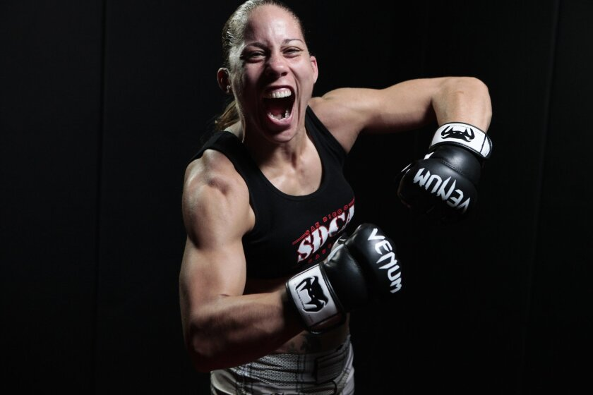"Liz ""Girl-Rilla"" Carmouche, an ex-Marine, is a top contender in Strikeforce and Invicta FC bantamweight division. She could fight champ Ronda Rousey soon. James Gregg • U-T"
