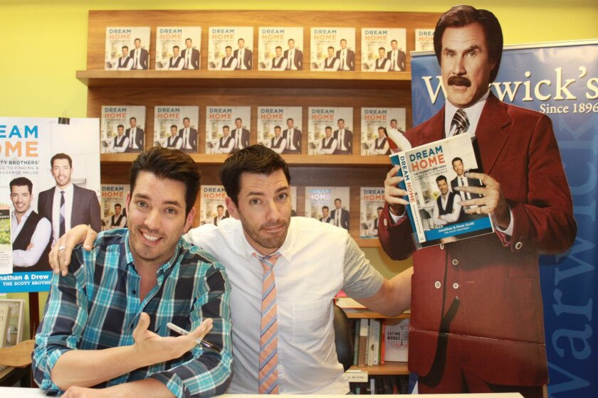Drew and Jonathan Scott pose with the Ron Burgundy cutout at Warwick's before their fans arrive.