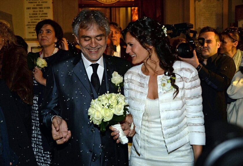 Italian opera singer Andrea Bocelli and his wife, Veronica Berti, after their wedding at Sanctuary of Montenero in Livorno, Italy, on March 21, 2014