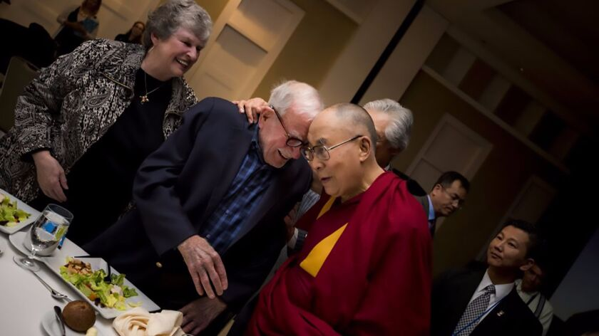Walter Munk with Mary Coakley-Munk, his wife since 2011, and the Dalai Lama, who was UC San Diego's