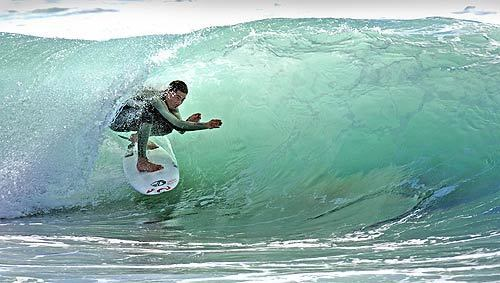 """Emery Kauanui, nicknamed """"The Flying Hawaiian"""" for his aerial manuevers, tucks into a tube at Windansea Beach in La Jolla. He was beaten to death in May 2007."""