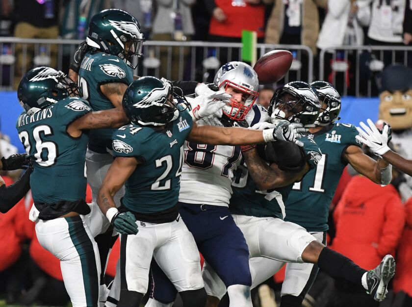 Patriots tight end Rob Gronkowski is swarmed by Eagles players on a Hail Mary during Super Bowl LII.