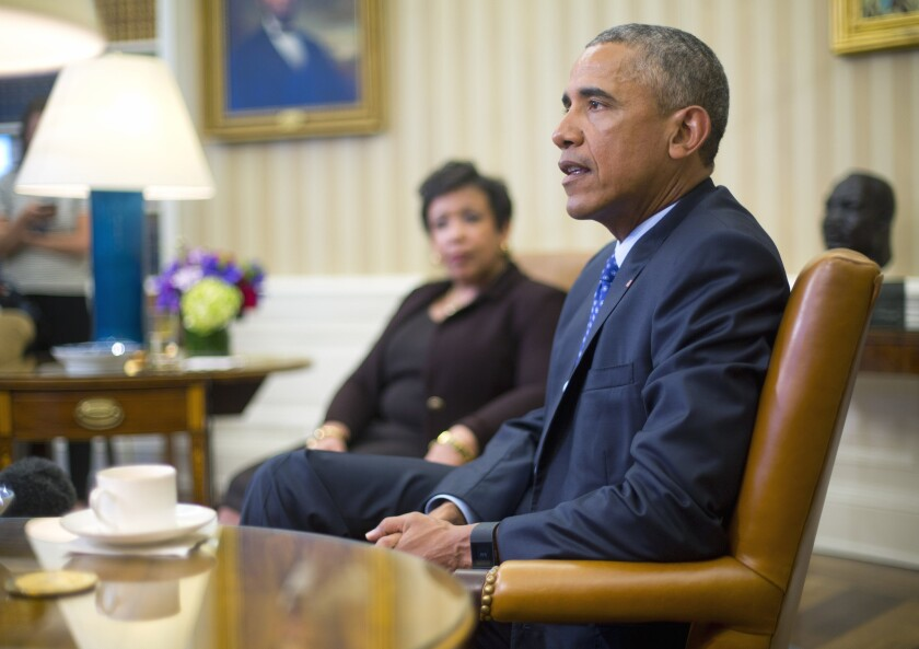 Atty. Gen. Loretta Lynch listens to President Obama in the Oval Office on Monday during a discussion on executive actions the president can take to curb gun violence.