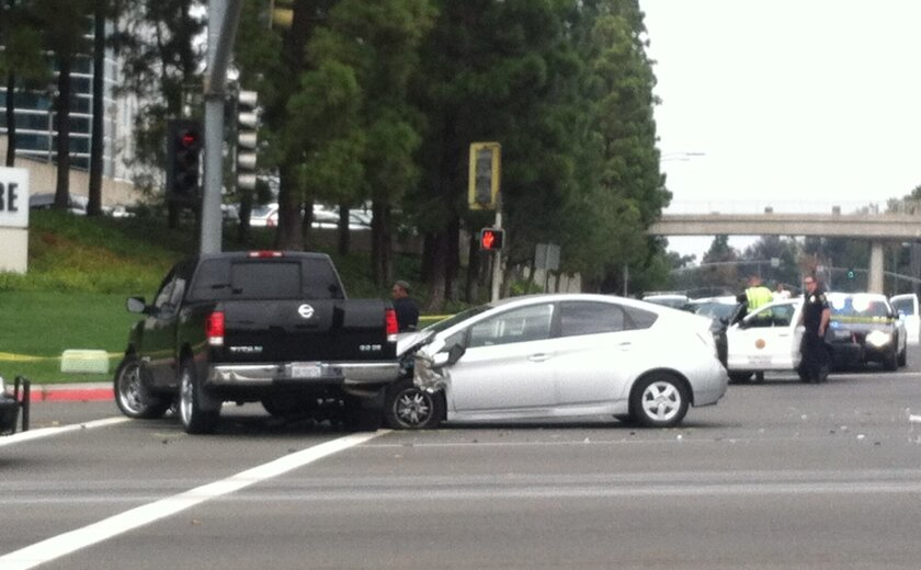 The female driver of a silver Prius ran a red light and hit three vehicles, ending with a pickup, in University City.