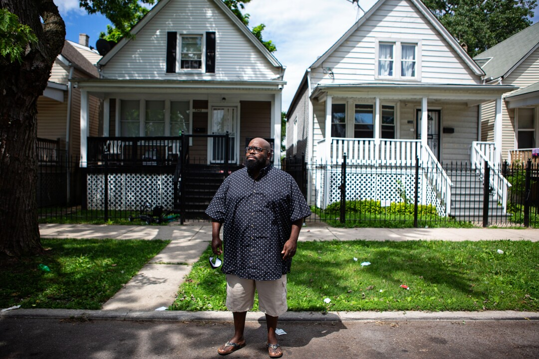 Donovan Price stands in front of the home where 13-year-old Deon Williams was shoot and killed.