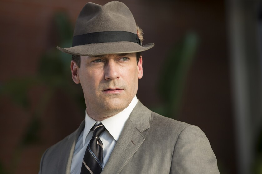 "Don Draper (Jon Hamm) in his gray suit and fedora looks like he's traveled to the West Coast via a time machine from 1960, in the season opener of ""Mad Men."""