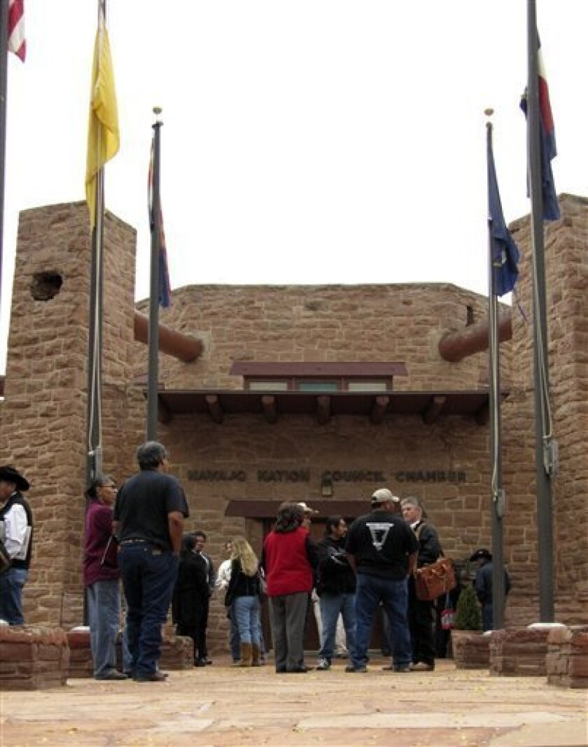 In this Oct. 21, 2010 photo, spectators gather outside of the Navajo Nation Council chambers in Window Rock, Ariz., . Tribal lawmakers were in executive session to debate the implications of criminal complaints issued in a probe of the council's discretionary funds.(AP Photo/Felicia Fonseca)
