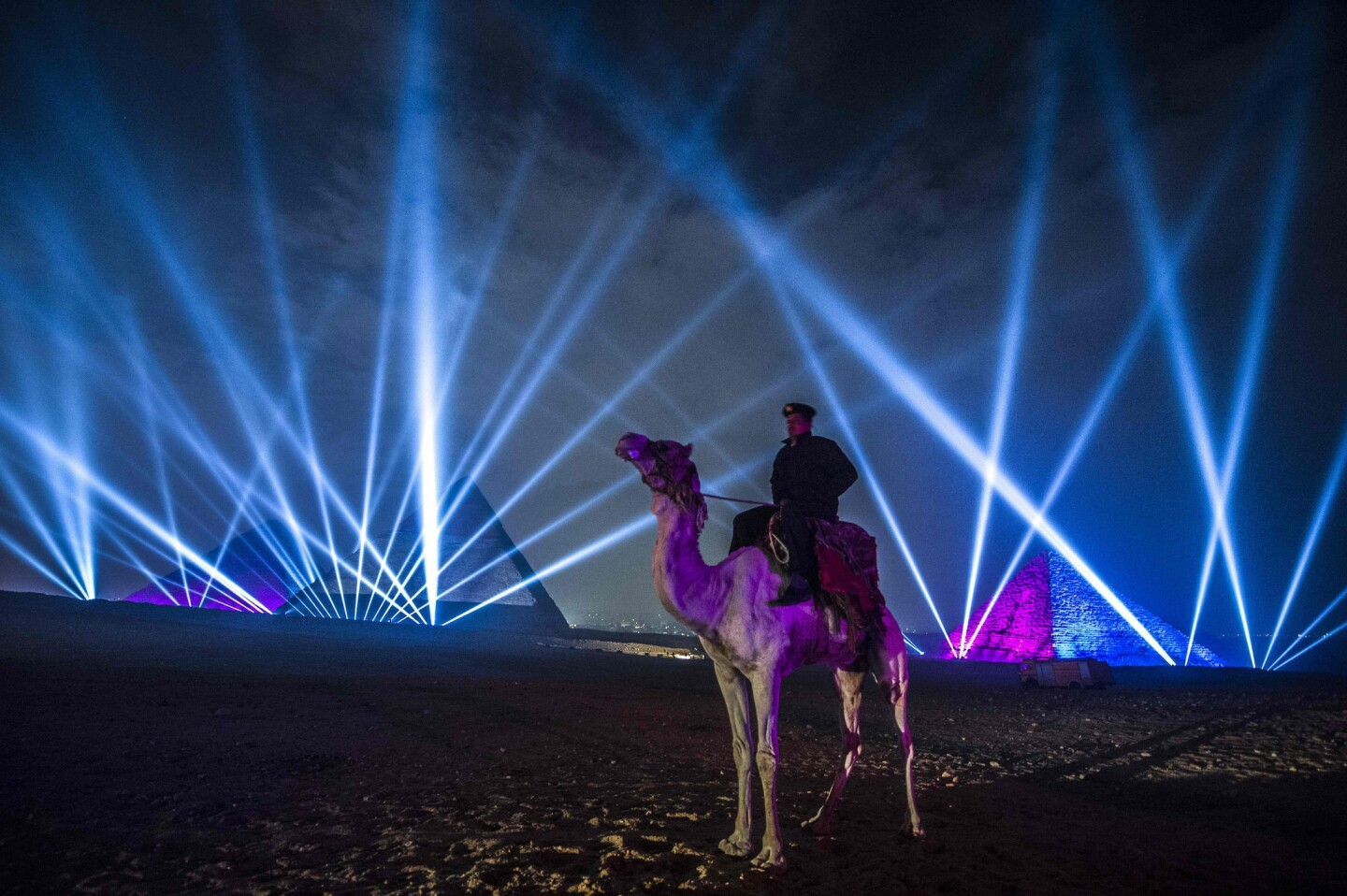 An Egyptian policeman stands guard during New Year celebrations in front of the pyramids near Cairo.